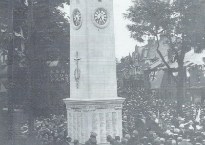 The unveiling of Isleworth War Memorial on 22 June 1922. His Grace the Duke of Northumberland attended with the member of parliament, Sir William Joyson-Hicks. The band of the Royal Fusiliers led the procession which formed in Lower Square. The photograph was taken looking towards South Street.
